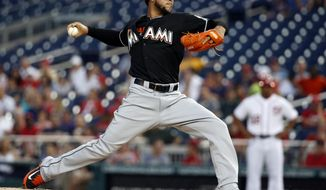 Miami Marlins starting pitcher Henderson Alvarez throws during the third inning of a baseball game against the Washington Nationals at Nationals Park, Wednesday, May 28, 2014, in Washington. (AP Photo/Alex Brandon)