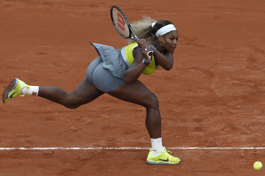 Serena Williams of the U.S. returns the ball during the second round match of the French Open tennis tournament against Spain's Garbine Muguruza at the Roland Garros stadium, in Paris, France, Wednesday, May 28, 2014. Williams lost in two sets 2-6, 2-6. (AP Photo/Darko Vojinovic)