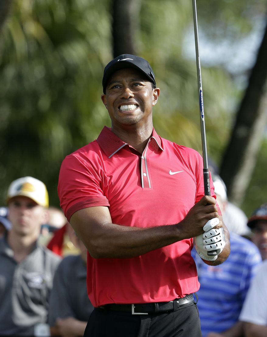 In this March 9, 2014, photo, Tiger Woods watches his tee shot on the 12th hole during the final round of the Cadillac Championship golf tournament in Doral, Fla. Woods withdrew from the U.S. Open on Wednesday, May 28, 2014, as he recovers from back surgery that has kept him out of golf for nearly three months. It will be the second U.S. Open, and sixth major, he has missed because of injury over the last six years. The U.S. Open is June 12-15 at Pinehurst No. 2, where Woods tied for third in 1999 and was runner-up in 2005. (AP Photo/Lynne Sladky)