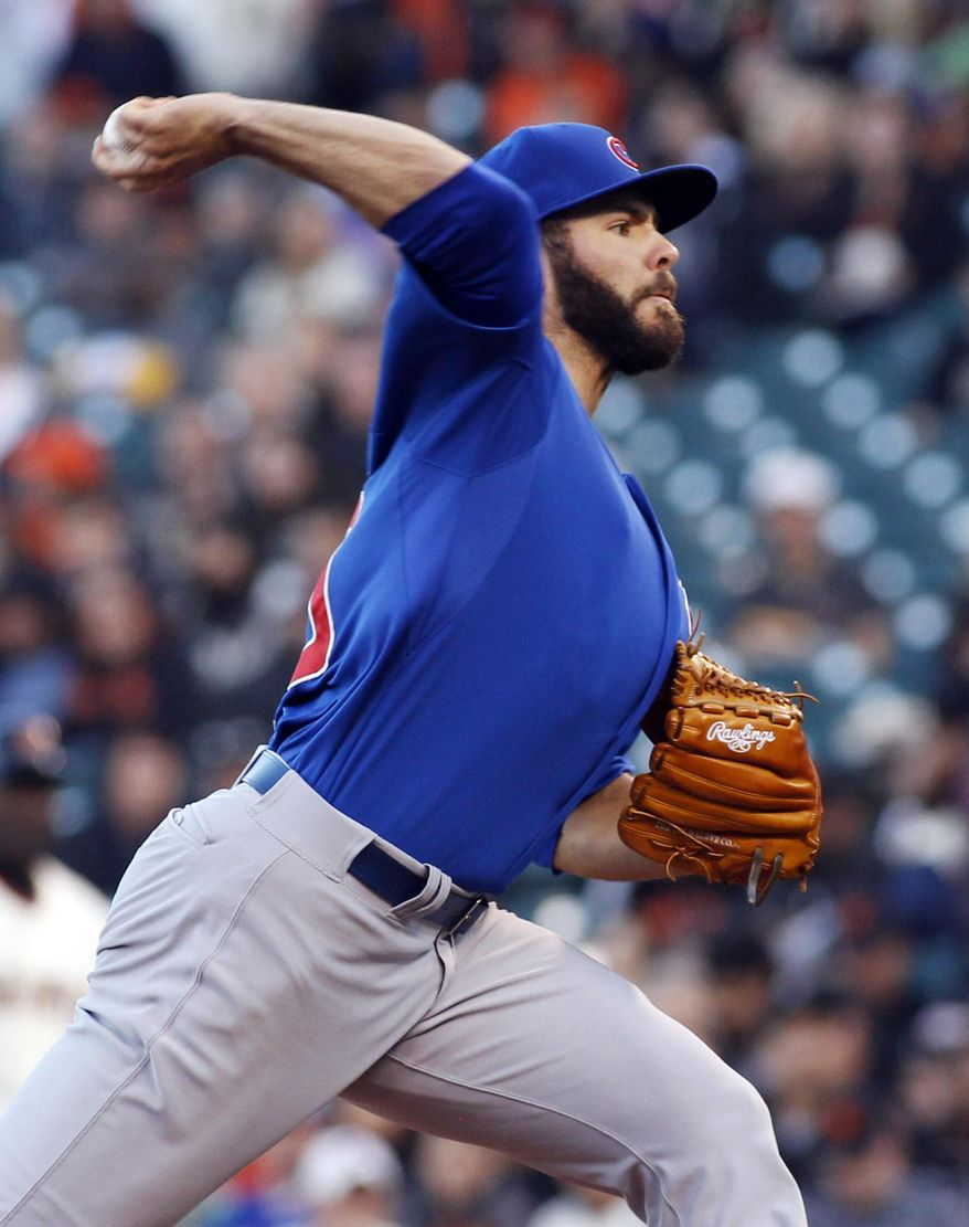 Chicago Cubs pitcher Jake Arrieta throws to the San Francisco Giants during the first inning of a baseball game, Tuesday, May 27, 2014, in San Francisco, (AP Photo/George Nikitin)