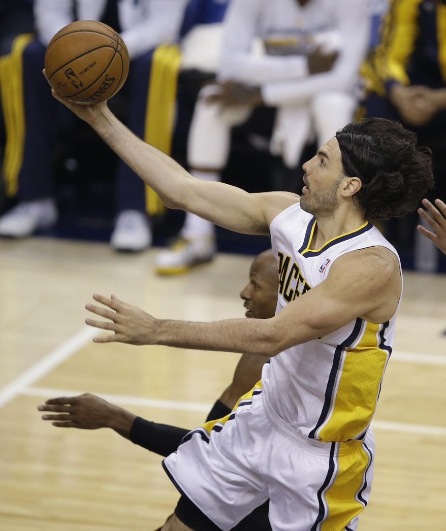 Indiana Pacers' Luis Scola puts up a shot against Miami Heat's Ray Allen during the first half of Game 5 of the Eastern Conference finals NBA basketball playoff series Wednesday, May 28, 2014, in Indianapolis. (AP Photo/Darron Cummings)