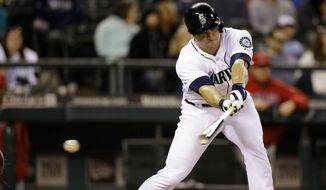 Seattle Mariners' Mike Zunino swings and misses to strike out and end the eighth inning of a baseball game against the Los Angeles Angels, Tuesday, May 27, 2014, in Seattle. (AP Photo/Elaine Thompson)