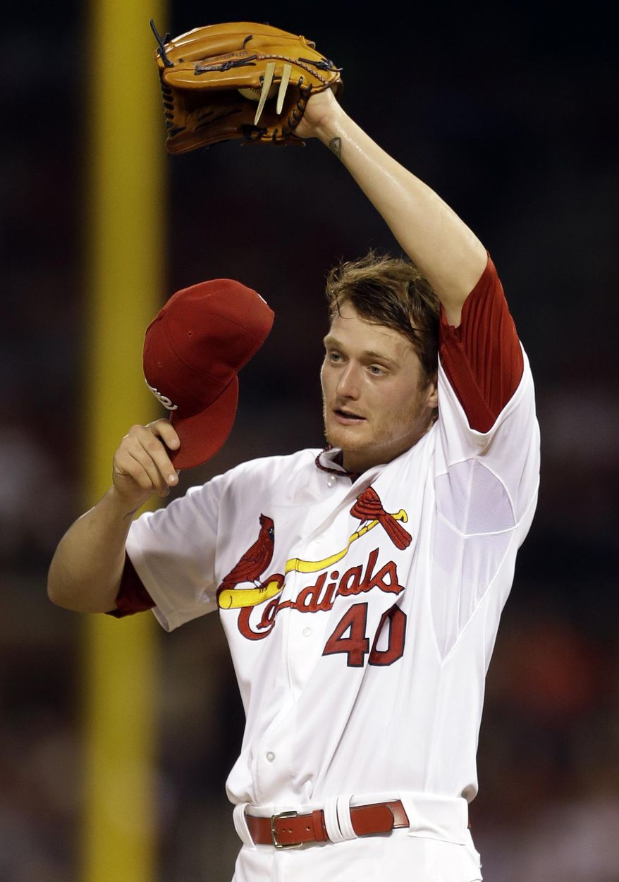 St. Louis Cardinals starting pitcher Shelby Miller pauses on the mound during the fourth inning of a baseball game against the New York Yankees on Wednesday, May 28, 2014, in St. Louis. (AP Photo/Jeff Roberson)
