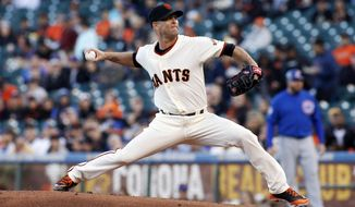 San Francisco Giants pitcher Tim Hudson throws to the Chicago Cubs during the first inning of a baseball game, Tuesday, May 27, 2014, in San Francisco. (AP Photo/George Nikitin)