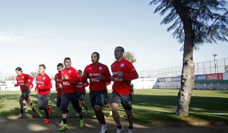 Chile's soccer players warm up during a training session in Santiago, Chile, Wednesday, May 28, 2014. Chile will play a friendly match with Egypt in Santiago on Friday prior to competing at the World Cup in Brazil in June. (AP Photo/Luis Hidalgo)