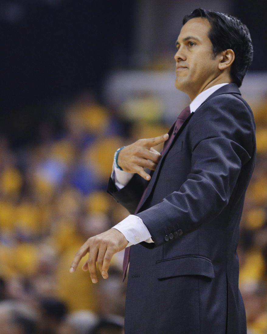 Miami Heat coach Erik Spoelstra gestures to the team during the first half of Game 5 of the NBA basketball Eastern Conference finals against the Indiana Pacers, in Indianapolis on Wednesday, May 28, 2014. (AP Photo/Michael Conroy)