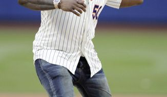 50 Cent throws out the ceremonial first pitch before a baseball game between the New York Mets and the Pittsburgh Pirates on Tuesday, May 27, 2014, in New York. (AP Photo/Frank Franklin II)