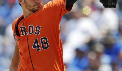 Houston Astros starting pitcher Jarred Cosart delivers to a Kansas City Royals batter during the first inning of a baseball game at Kauffman Stadium in Kansas City, Mo., Wednesday, May 28, 2014. (AP Photo/Orlin Wagner)