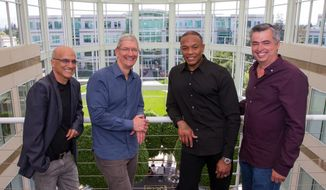 In this image provided by Apple, from left to right, music entrepreneur and Beats co-founder Jimmy Iovine, Apple CEO Tim Cook, Beats co-founder Dr. Dre, and Apple senior vice president Eddy Cue pose together at Apple headquarters in Cupertino, Calif., Wednesday, May 28, 2014. Apple is striking a new chord with a $3 billion acquisition of Beats Electronics, a headphone and music streaming specialist that also brings the swagger of rapper Dr. Dre and recording impresario Jimmy Iovine. The announcement on Wednesday comes nearly three weeks after deal negotiations were leaked to the media. (AP Photo/Apple, Paul Sakuma)
