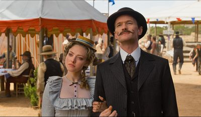"This image released by Universal Pictures shows, Amanda Seyfried, left, and  Neil Patrick Harris in a scene from ""A Million Ways to Die in the West."" (AP Photo/Universal Pictures)"