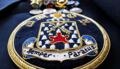 """ADVANCE FOR USE MONDAY, JUNE 2, 2014, AND THEREAFTER - This April 2, 2014, photo shows a 16th Infantry Regiment patch with the Latin motto """"Always Prepared"""" that decorates Ray Lambert's blazer at his home in Seven Lakes, N.C. Of the 31 men in the landing craft he rode onto Omaha Beach on D-Day, only seven made it ashore, and four of those, included Lambert, were wounded. (AP Photo/Allen G. Breed)"""