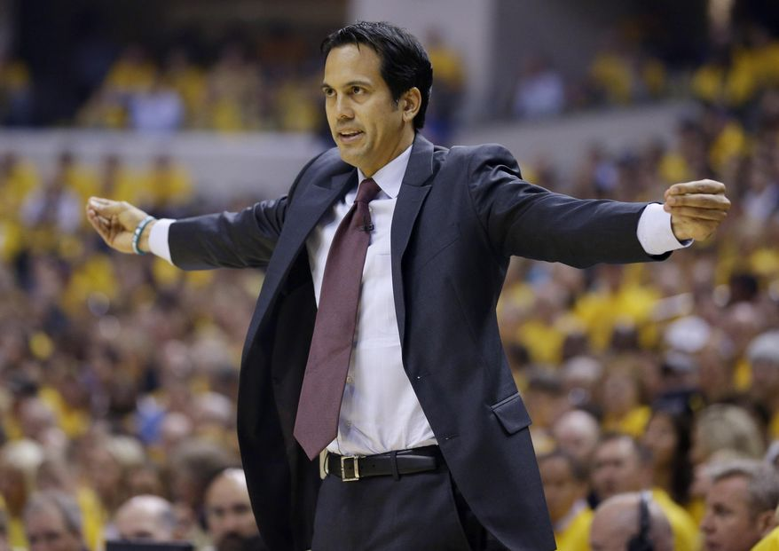 Miami Heat coach Erik Spoelstra signals to the team during the first half against the Indiana Pacers in Game 5 of the NBA basketball Eastern Conference finals in Indianapolis, Wednesday, May 28, 2014. (AP Photo/Michael Conroy)