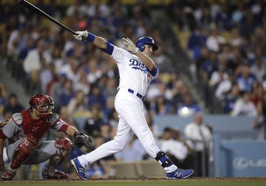 Los Angeles Dodgers' Andre Ethier follows through on a three-run triple during the fourth inning of a baseball game against the Cincinnati Reds on Tuesday, May 27, 2014, in Los Angeles. (AP Photo/Jae C. Hong)