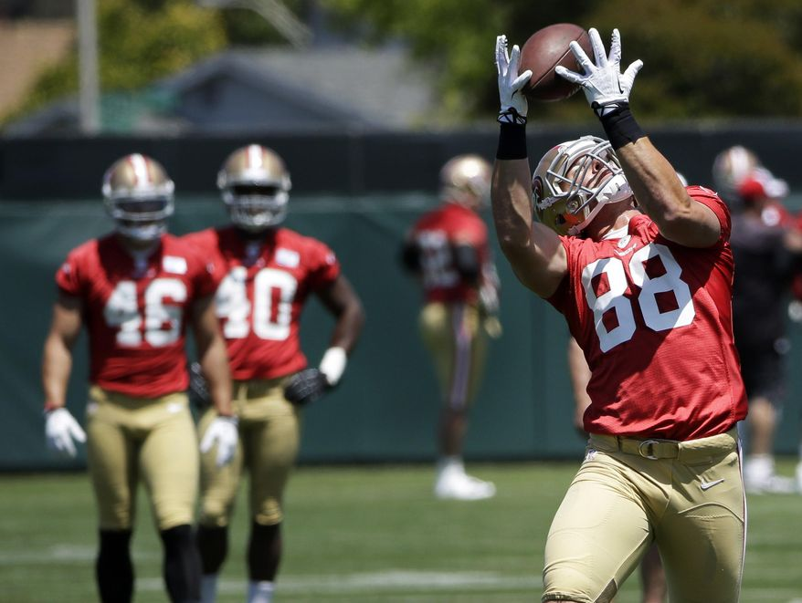 San Francisco 49ers' Garrett Celek makes a catch during an NFL football organized team activity Wednesday, May 28, 2014, in Santa Clara, Calif. (AP Photo/Marcio Jose Sanchez)