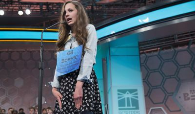 "Sophie Bergman of Bettendorf, Iowa, spells the word ""Cartesian"" correctly during the preliminary round of the National Spelling Bee, Wednesday, May 28, 2014, in Oxon Hill, Md. (AP Photo/ Evan Vucci)"