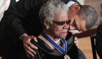 President Barack Obama kissing author and poet Maya Angelou after awarding her the 2010 Medal of Freedom during a ceremony in the East Room of the White House in Washington. (AP Photo/Pablo Martinez Monsivais, File)