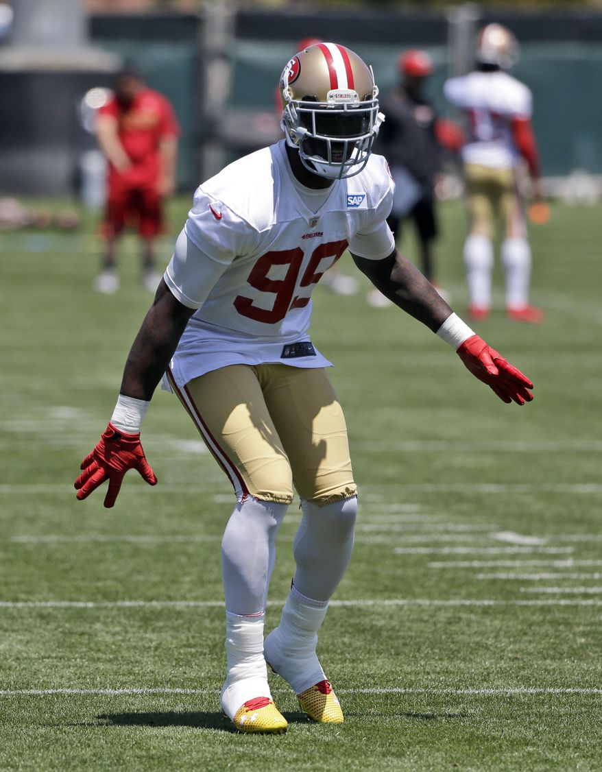 San Francisco 49ers' Aldon Smith goes through drills during an NFL football organized team activity Wednesday, May 28, 2014, in Santa Clara, Calif. (AP Photo/Marcio Jose Sanchez)