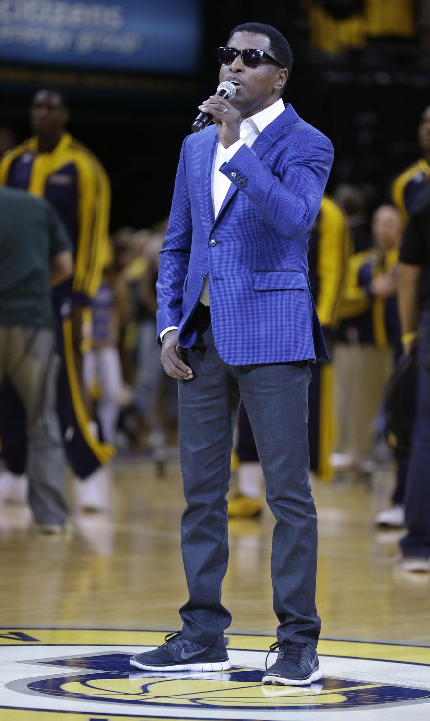 "Kenneth ""Babyface"" Edmonds sings the U.S. national anthem before Game 5 of the NBA basketball playoffs Eastern Conference finals between the Indiana Pacers and the Miami Heat, in Indianapolis on Wednesday, May 28, 2014. (AP Photo/Michael Conroy)"