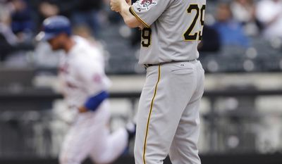 Pittsburgh Pirates relief pitcher Bryan Morris reacts as New York Mets' Lucas Duda heads to home plate after hitting a two-run home run during the eighth inning of a baseball game Wednesday, May 28, 2014, in New York. (AP Photo/Frank Franklin II)