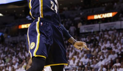 Indiana Pacers forward Paul George (24) dunks the ball during the first half of Game 4 in the NBA basketball Eastern Conference finals playoff series against the Miami Heat, Monday, May 26, 2014, in Miami. (AP Photo/Wilfredo Lee)