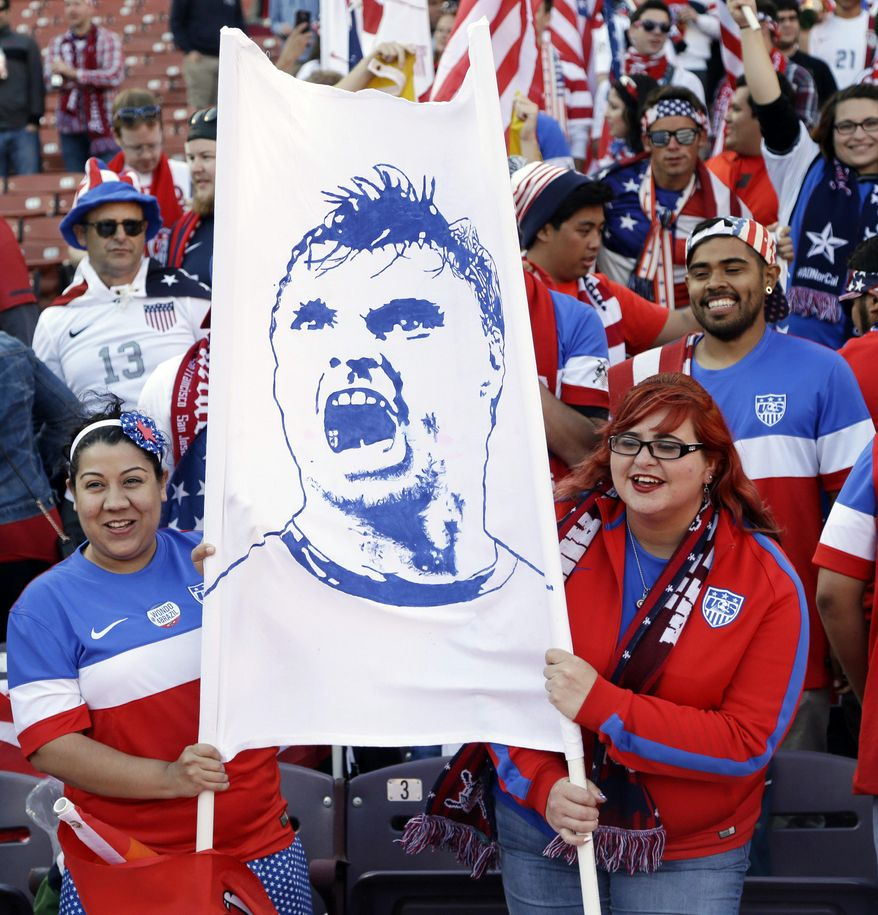 Fans hold an image of the United States' Chris Wondolowski before the start of an international friendly soccer match between the United States and Azerbaijan on Tuesday, May 27, 2014, in San Francisco. (AP Photo/Marcio Jose Sanchez)