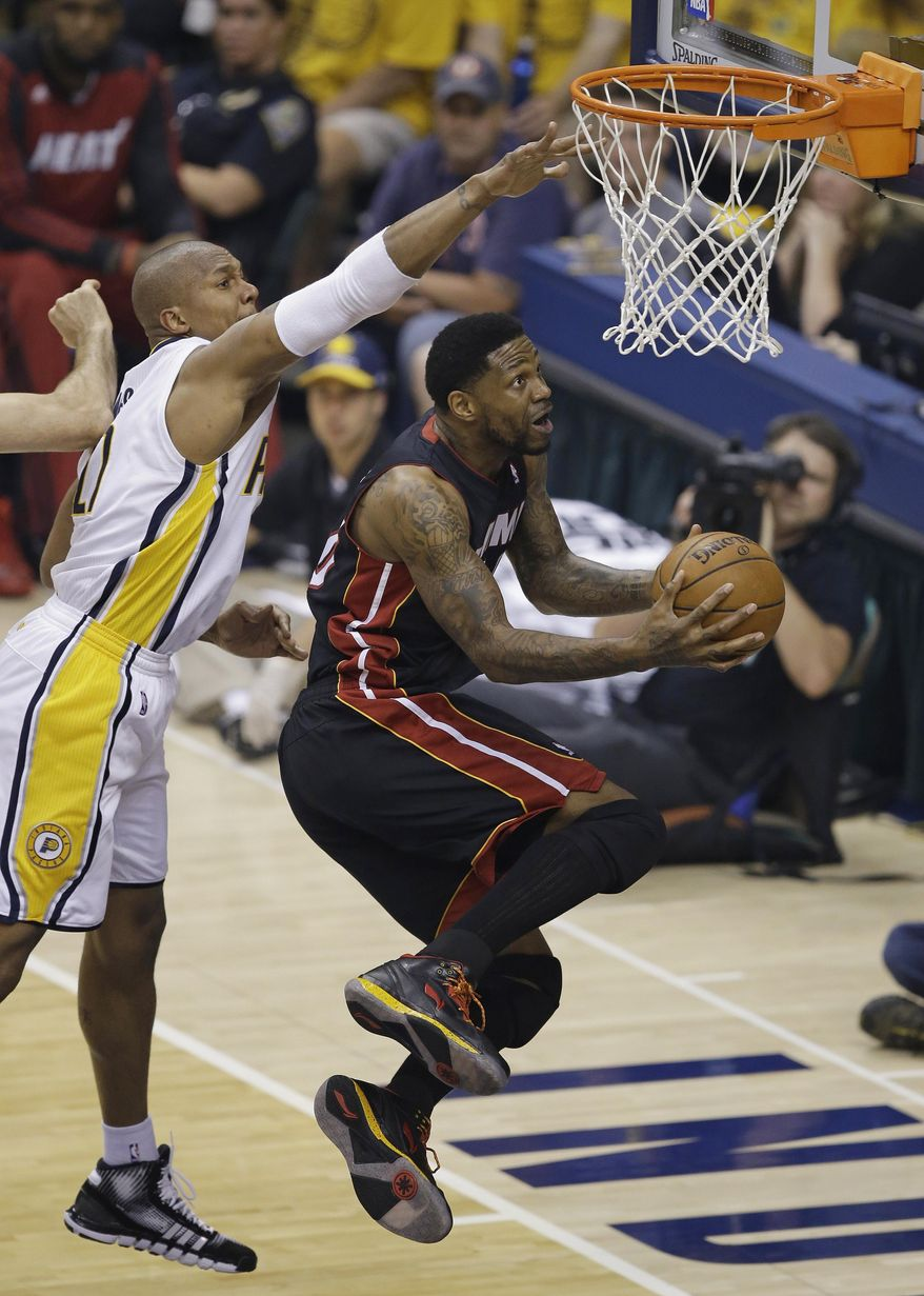 Miami Heat's Udonis Haslem goes to the basket against Indiana Pacers' David West during the first half of Game 5 of the Eastern Conference finals NBA basketball playoff series Wednesday, May 28, 2014, in Indianapolis. (AP Photo/Darron Cummings)