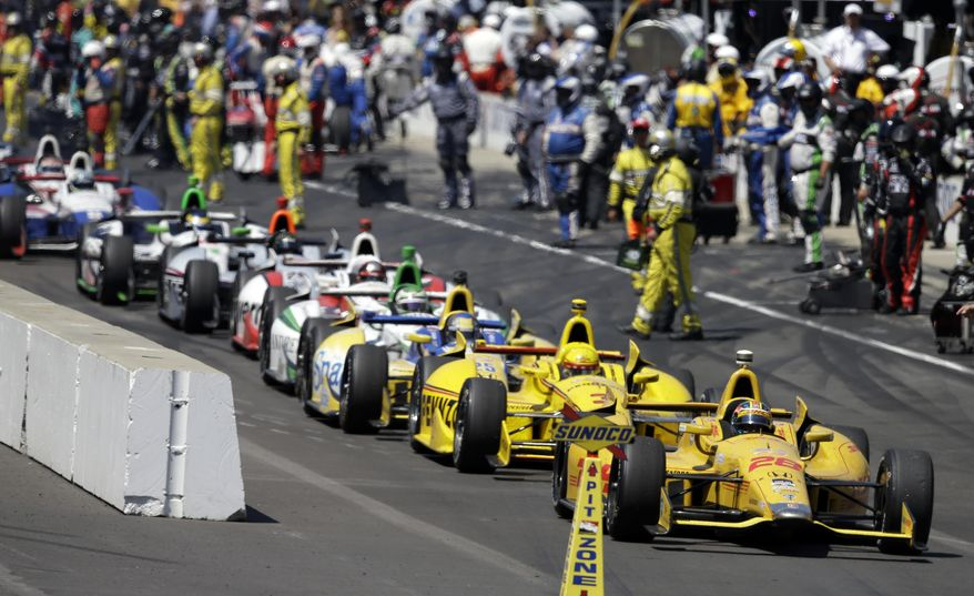 Ryan Hunter-Reay leads the cars of pit lane following a red flag during the 98th running of the Indianapolis 500 IndyCar auto race at the Indianapolis Motor Speedway to resume during a red flag in Indianapolis, Sunday, May 25, 2014. (AP Photo/Darron Cummings)