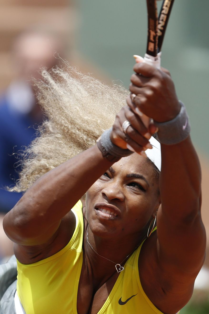 Serena Williams of the U.S. returns the ball during the second round match of the French Open tennis tournament against Spain's Garbine Muguruza at the Roland Garros stadium, in Paris, France, Wednesday, May 28, 2014. (AP Photo/Darko Vojinovic)