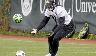 Pittsburgh Steelers running back LeGarrette Blount goes through drills during an NFL football organized team activity on Wednesday, May 28, 2014 in Pittsburgh. (AP Photo/Keith Srakocic)
