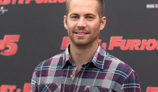 """FILE - In this April 29, 2011 file photo, actor Paul Walker poses during the photo call of the movie """"Fast and Furious 5,"""" in Rome. Walker's daughter Meadow Rain Walker will live with her mother and a nanny, a court appointed attorney told a Los Angeles Superior Court commissioner during a hearing on Wednesday, May 28, 2014. Commissioner David Cowan dismissed a guardianship proceeding over the 15-year-old after hearing details about who will care for her. (AP Photo/Andrew Medichini, File)"""
