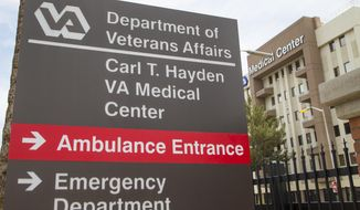"""The Carl T. Hayden VA Medical Center in Phoenix is seen Wednesday May 28, 2014.  About 1,700 veterans in need of care were """"at risk of being lost or forgotten"""" after being kept off the official waiting list at the Phoenix veterans hospital, the Veterans Affairs watchdog said Wednesday.  (AP Photo/The Arizona Republic, Michael Chow)  MARICOPA COUNTY OUT; MAGS OUT; NO SALES"""