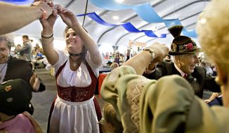 In this photo taken on Sept. 6, 2009, Cindy White, left, and Walter Schwemmer, right, dance to the Bavarian musical group Alpiners USA as part of the Oktoberfest celebration at Snowbird Mountain Resort in Utah. Utah's state liquor commission is tightening up on issuing permits for weekend events like Snowbird Ski Resort's annual Oktoberfest. (AP Photo/The Deseret News, Mike Terry)  SALT LAKE TRIBUNE OUT;  MAGS OUT