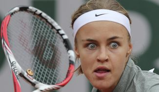Slovakia's Anna Schmiedlova eyes the ball during the second round match of the French Open tennis tournament against Venus Williams of the U.S. at the Roland Garros stadium, in Paris, France, Wednesday, May 28, 2014. (AP Photo/David Vincent)