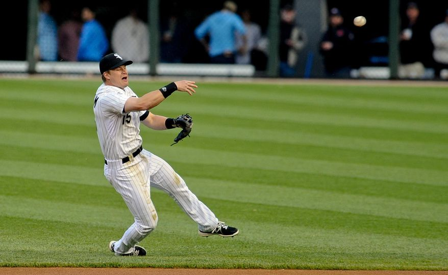 Chicago White Sox second baseman Gordon Beckham throws Cleveland Indians left fielder Michael Brantley out at first during the first inning of a baseball game in Chicago on Wednesday, May 28, 2014. (AP Photo/ Matt Marton)