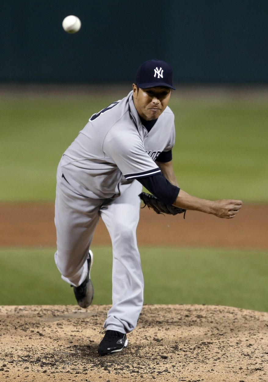 New York Yankees starting pitcher Hiroki Kuroda throws during the fourth inning of a baseball game against the St. Louis Cardinals on Wednesday, May 28, 2014, in St. Louis. (AP Photo/Jeff Roberson)