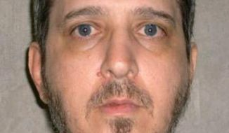 This photo provided by the Oklahoma Department of Corrections shows Richard Glossip. An Oklahoma court has scheduled a Nov. 20, 2014 execution date for the convicted killer while the state's protocol is under review following a botched execution. The Oklahoma Court of Criminal Appeals on Glossip has exhausted his appeals. (AP Photo/Oklahoma Department of Corrections)