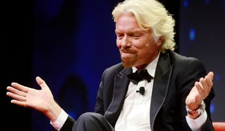 Sir Richard Branson, founder of the Virgin Group, talks about his business and adventures during the Economic Club of Grand Rapids annual dinner at the DeVos Placein Grand Rapids, Mich., on Tuesday, May 27, 2014. (AP Photo/The Grand Rapids Press, Emily Rose Bennett) ** FILE **