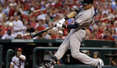 New York Yankees' Jacoby Ellsbury hits an RBI single during the third inning of a baseball game against the St. Louis Cardinals on Wednesday, May 28, 2014, in St. Louis. (AP Photo/Jeff Roberson)