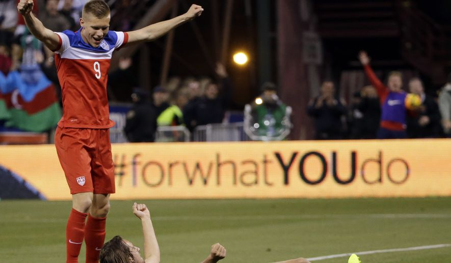 United States' Mix Diskerud, bottom, celebrates his goal with teammate Aron Johannsson, left, during the second half of an international friendly soccer match against Azerbaijan on Tuesday, May 27, 2014, in San Francisco. United States won 2-0. (AP Photo/Marcio Jose Sanchez)