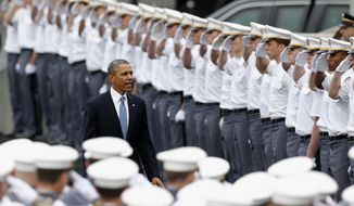 """President Barack Obama arrives to a graduation and commissioning ceremony at the U.S. Military Academy on Wednesday, May 28, 2014, in West Point, N.Y. In a broad defense of his foreign policy, the president declared  that the U.S. remains the world's most indispensable nation, even after a """"long season of war,"""" but argued for restraint before embarking on more military adventures. (AP Photo/Mike Groll)"""