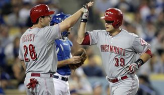 Cincinnati Reds' Devin Mesoraco, right, celebrates his two-run home run with Chris Heisey during the eighth inning of a baseball game against the Los Angeles Dodgers on Tuesday, May 27, 2014, in Los Angeles. (AP Photo/Jae C. Hong)
