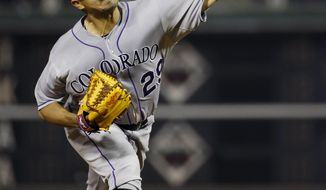 Colorado Rockies' Jorge De La Rosa pitches during the second inning of a baseball game against the Philadelphia Phillies, Tuesday, May 27, 2014, in Philadelphia. (AP Photo/Matt Slocum)