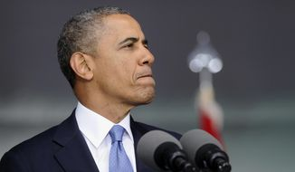 """President Barack Obama pauses while delivering the commencement address to the U.S. Military Academy at West Point's Class of 2014, in West Point, N.Y., Wednesday, May 28, 2014. In a broad defense of his foreign policy, the president declared  that the U.S. remains the world's most indispensable nation, even after a """"long season of war,"""" but argued for restraint before embarking on more military adventures. (AP Photo/Susan Walsh)"""