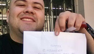This image provided by Sergio Loza shows Loza holding up an envelope that had cash hidden in it in San Francisco, on Sunday, May 25, 2014. Loza followed the clues from a Twitter user using the handle @HiddenCash to find the money. The mysterious person has been hiding money throughout the city since Friday that's leading scores on a scavenger hunt.  (AP Photo/Sergio Loza)