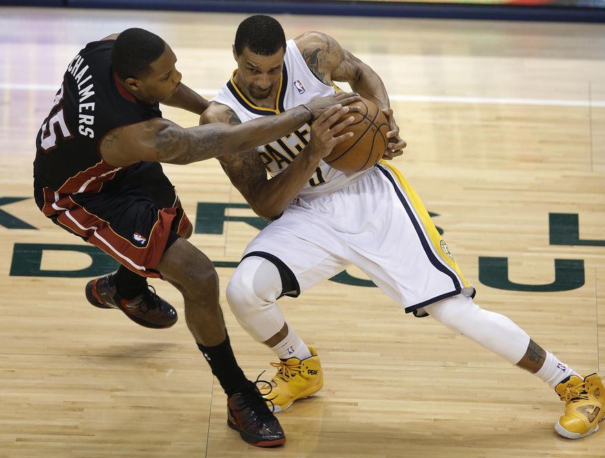 Indiana Pacers' George Hill is fouled by Miami Heat's Mario Chalmers during the first half of Game 5 of the Eastern Conference finals NBA basketball playoff series Wednesday, May 28, 2014, in Indianapolis. (AP Photo/Darron Cummings)
