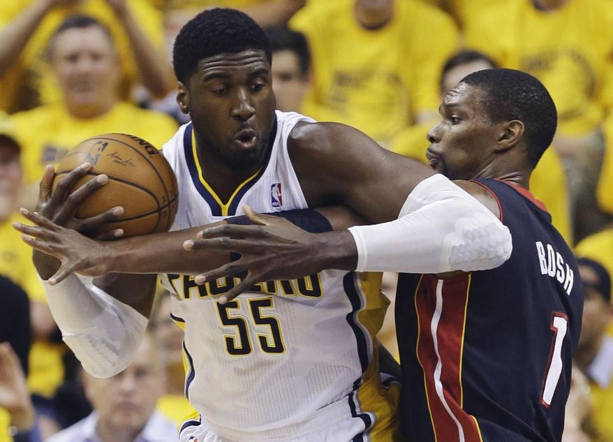 Indiana Pacers center Roy Hibbert (55) is defended by Miami Heat center Chris Bosh (1) during the first half of Game 5 of the NBA basketball Eastern Conference finals, in Indianapolis, Wednesday, May 28, 2014. (AP Photo/Michael Conroy)