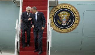 President Barack Obama and Senate Armed Service Committee member Sen. Jack Reed, D-R.I., laugh as they walk down the steps from Air Force One, upon their arrival at the Stewart Air National Guard Base in Newburgh, N.Y., Wednesday, May 28, 2014, before heading to the United States Military Academy at West Point where the president was to deliver the commencement address. (AP Photo/Philip Kamrass)