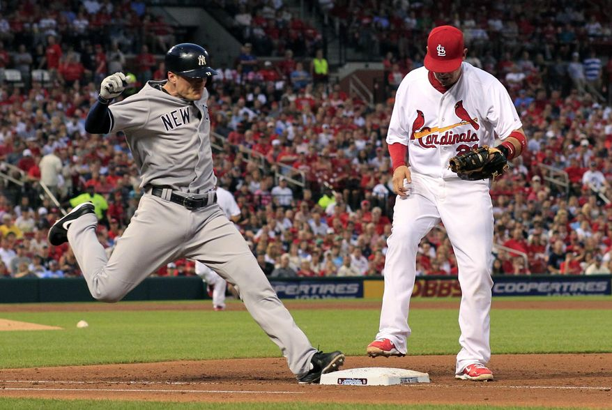 New York Yankees' Brendan Ryan, left, is out as St. Louis Cardinals first baseman Allen Craig lifts his foot up after tagging the bag during the third inning of a baseball game Wednesday, May 28, 2014, in St. Louis. (AP Photo/Jeff Roberson)