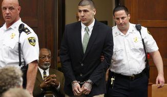 Former New England Patriots tight end Aaron Hernandez is led into the courtroom to be arraigned on homicide charges at Suffolk Superior Court in Boston, Wednesday, May 28, 2014. Hernandez pleaded not guilty in the shooting deaths of Daniel de Abreu and Safiro Furtado. He already faces charges in the 2013 killing of semi-pro football player Odin Lloyd. (AP Photo/Dominick Reuter, Pool)