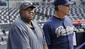 In this June 11, 2013, photo, Hall-of-Fame baseball player Tony Gwynn, left, watches with Padres manager Bud Black as Padres players prepare for a baseball game in San Diego. Gwynn remains in the thoughts of his San Diego State Aztecs, who have reached the NCAA regionals for the second straight season. Gwynn has been on a medical leave of absence since late March. (AP Photo/Lenny Ignelzi)